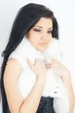 Pretty girl wearing white fur Royalty Free Stock Image