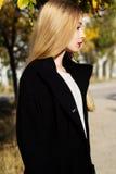 Pretty girl is wearing winter black coat Stock Photography