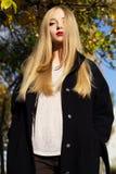 Pretty girl is wearing winter black coat Stock Image