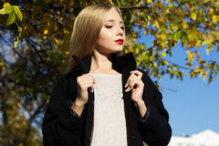 Pretty girl is wearing winter black coat Royalty Free Stock Photography