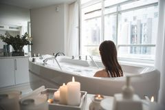 Woman during spa procedure in bath indoor royalty free stock image