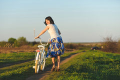 Pretty Girl with WHite Bicycle Stock Photo