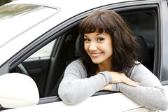 Pretty girl and white car Stock Image