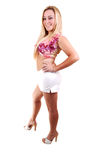 Pretty girl in white shorts. Young, lovely girl in a short white shorts with blond hair, smiling into the camera Stock Photos