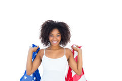 Pretty girl in white top holding american flag Royalty Free Stock Images