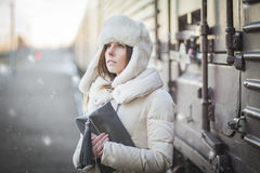 Pretty girl in winter blizzard on railroad station Royalty Free Stock Photography