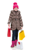 Pretty girl in winter clothes with shopping bags Royalty Free Stock Image