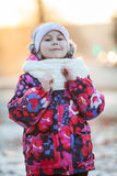 Pretty girl in winter clothes standing outdoor. White scarf and hat Royalty Free Stock Image