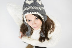 Pretty girl in winter clothing looking up and smiling. Royalty Free Stock Photography
