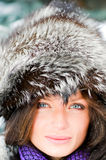 Pretty girl in winter forest Royalty Free Stock Image