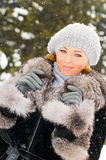 Pretty girl in winter park Royalty Free Stock Image