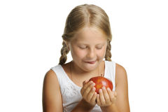 The pretty girl wishes to eat an apple Stock Image