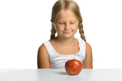 The pretty girl wishes to eat an apple Royalty Free Stock Images
