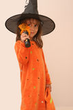 Pretty girl in witch costume Stock Photos