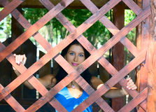 Pretty girl and wooden web Stock Photos