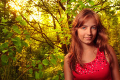 Pretty girl in woods Stock Images