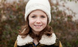 Pretty girl with wool hat in a park Royalty Free Stock Image