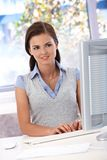 Pretty girl working with computer smiling Stock Photography
