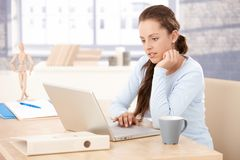 Pretty girl working at home on laptop Royalty Free Stock Photography