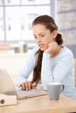 Pretty girl working at home on laptop Stock Photography
