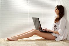 Pretty girl working the laptop Stock Photography