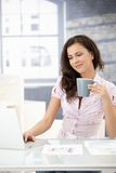 Pretty girl working on laptop in bright office Stock Photos