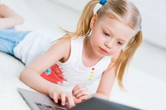 Pretty girl working on a laptop Stock Photos