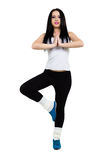 Pretty girl working out exercise. Portrait of pretty girl working out exercise, isolated on white background Royalty Free Stock Image