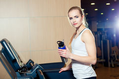 Pretty girl working out in a treadmill at the gym Stock Images