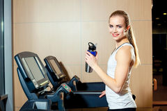 Pretty girl working out in a treadmill at the gym Royalty Free Stock Photo