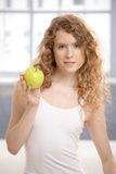 Pretty girl after workout with apple in hand Stock Image
