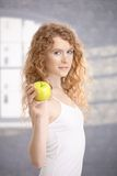 Pretty girl after workout holding apple in hand Royalty Free Stock Image
