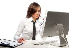 Pretty girl works on a computer Royalty Free Stock Images