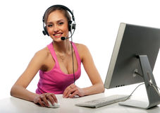 Pretty girl works on a computer Royalty Free Stock Photo