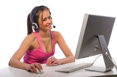 Pretty girl works on a computer Stock Photos
