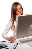 Pretty girl works on a computer Stock Images