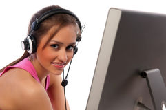 Pretty girl works on a computer Stock Image