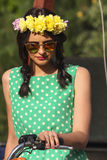 Pretty girl with wreath of flowers Stock Image