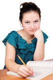 Pretty girl writes Royalty Free Stock Photo