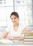 Pretty girl writing homework smiling Stock Photo