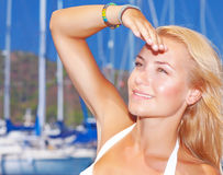 Pretty girl in yacht harbor Stock Photography