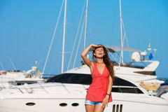 Pretty girl at the yacht harbor. Portrait of a pretty girl at the yacht harbor in summer day Stock Photo