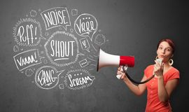 Girl yelling into megaphone and hand drawn speech bubbles come out. Pretty girl yelling into megaphone and hand drawn speech bubbles come out stock images