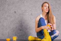 Pretty girl in yellow boots Stock Photos