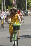 Pretty girl with yellow dress on bike Stock Photo