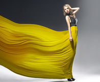 Pretty girl with yellow dress Royalty Free Stock Image