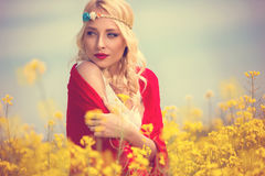 Pretty girl in yellow flowers Stock Photos