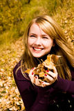 Pretty girl with yellow leaves in her hands Royalty Free Stock Images