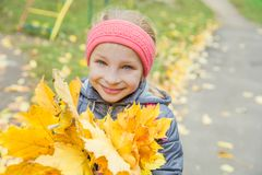 Pretty girl with yellow leaves Stock Photos