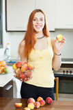 Pretty girl in yellow with peaches Royalty Free Stock Image